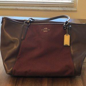 Burgundy coach purse